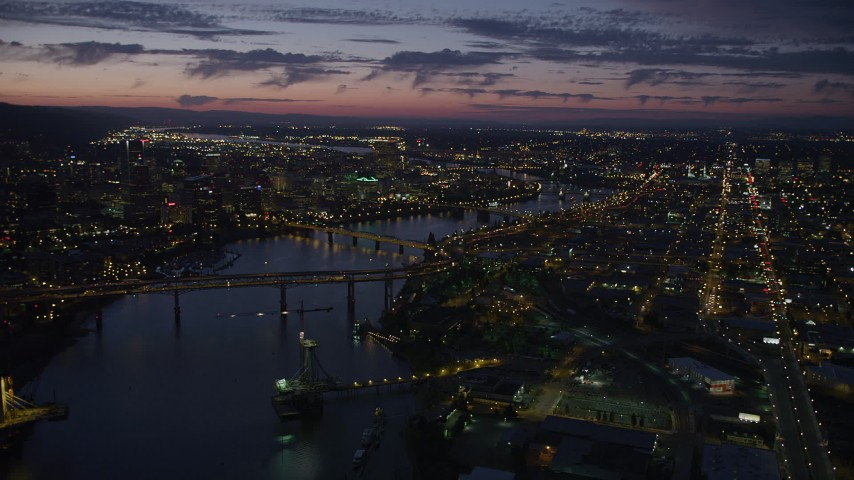 5K stock footage aerial video of downtown and the Willamette River at twilight, seen from Ross Island Bridge, Downtown Portland, Oregon Aerial Stock Footage | AX55_013