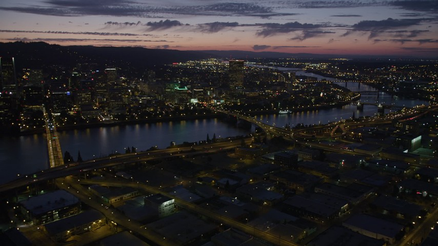 5K stock footage aerial video of downtown skyscrapers, Morrison Bridge, Burnside Street Bridge, Downtown Portland, Oregon, twilight Aerial Stock Footage | AX55_016