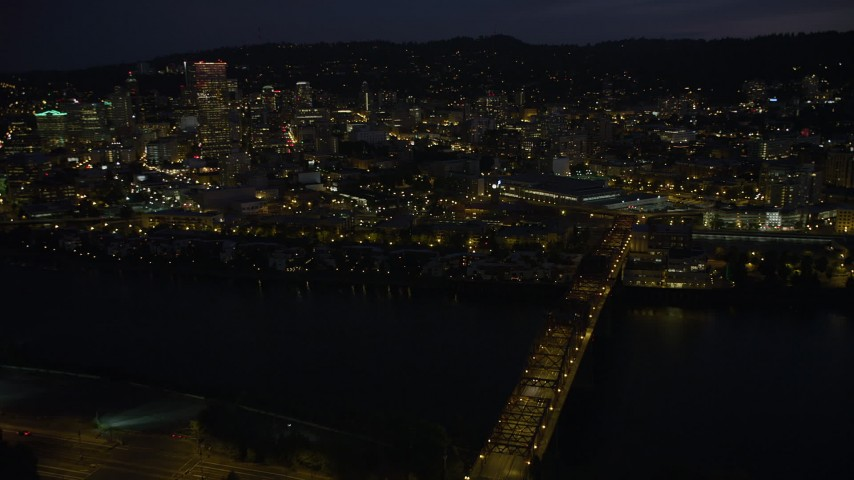 5K aerial video approach the Steel Bridge to reveal skyscrapers in Downtown Portland, Oregon, night Aerial Stock Footage | AX55_022