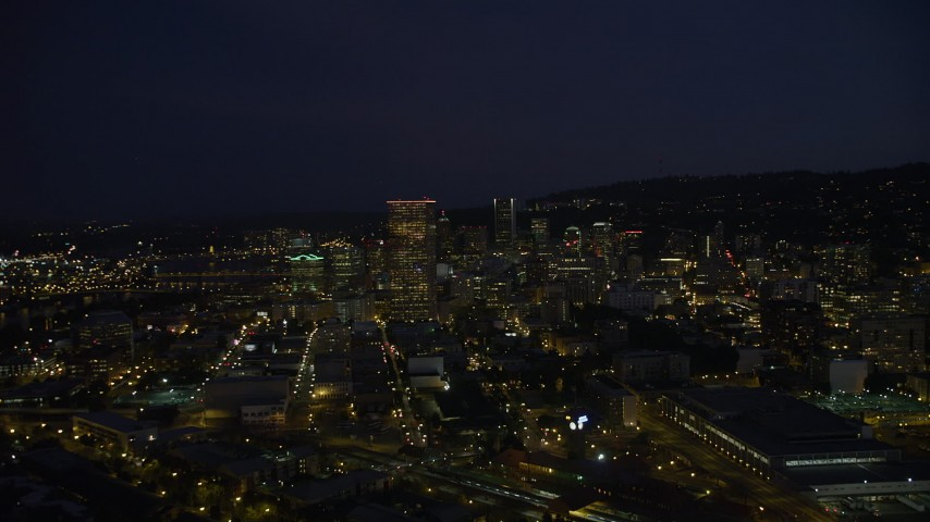 5K stock footage aerial video of flying by US Bancorp Tower and skyscrapers in Downtown Portland, Oregon, night Aerial Stock Footage | AX55_023