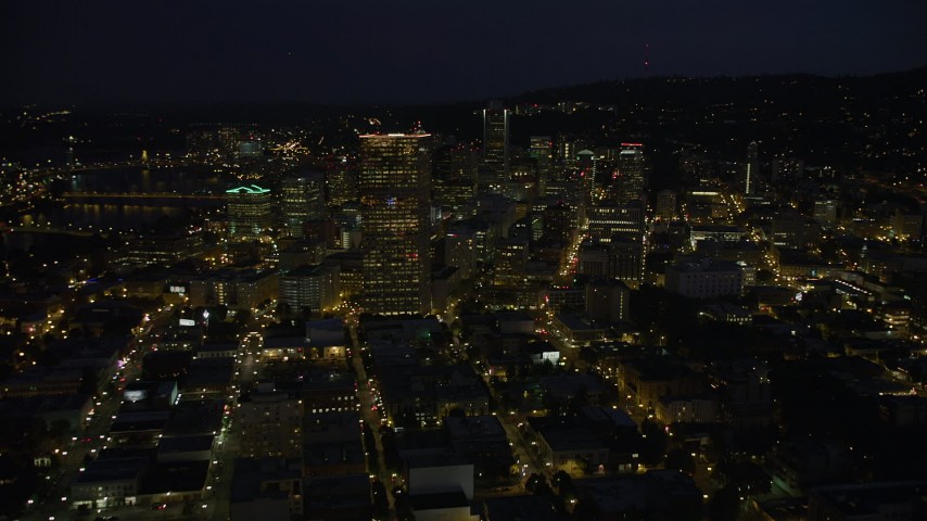 5K stock footage aerial video of approaching US Bancorp Tower and skyscrapers in Downtown Portland, Oregon, night Aerial Stock Footage | AX55_027