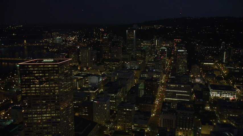 5K stock footage aerial video fly over downtown to approach KOIN Center and Wells Fargo Center, Downtown Portland, Oregon, night Aerial Stock Footage | AX55_028