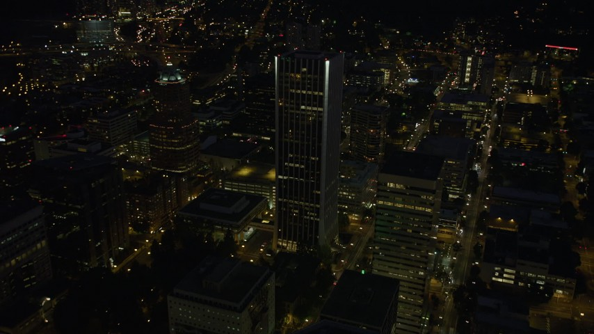 5K stock footage aerial video of flying by Wells Fargo Center, KOIN Center, Downtown Portland, Oregon, night Aerial Stock Footage | AX55_029