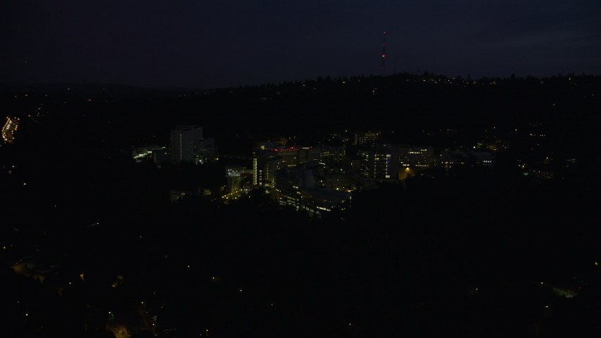 5K stock footage aerial video of approaching Oregon Health and Science University, Portland, Oregon, night Aerial Stock Footage | AX55_030