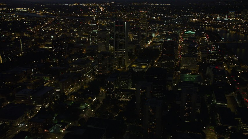 5K stock footage aerial video flyby Wells Fargo Center and KOIN Center in Downtown Portland, Oregon, night Aerial Stock Footage | AX55_031