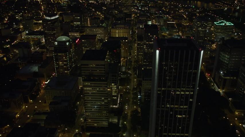 Following SW 5th Avenue through Downtown Portland, Oregon, night Aerial Stock Footage   AX55_033