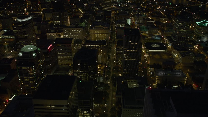 5K stock footage aerial video of following SW 5th Avenue through Downtown Portland, Oregon, night Aerial Stock Footage | AX55_033