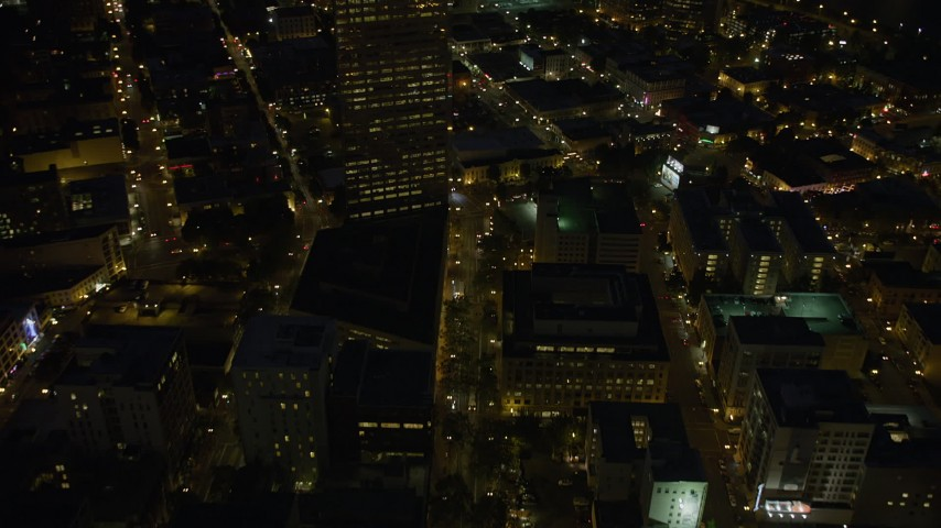 5K aerial video follow SW 5th Avenue to reveal US Bancorp Tower and Broadway Bridge, Downtown Portland, Oregon, night Aerial Stock Footage | AX55_034