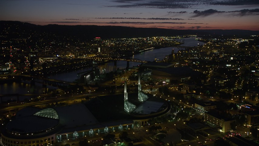 5K stock footage aerial video approach Oregon Convention Center, Broadway Bridge, Willamette River, Lloyd District, Northeast Portland, Oregon, night Aerial Stock Footage | AX55_037