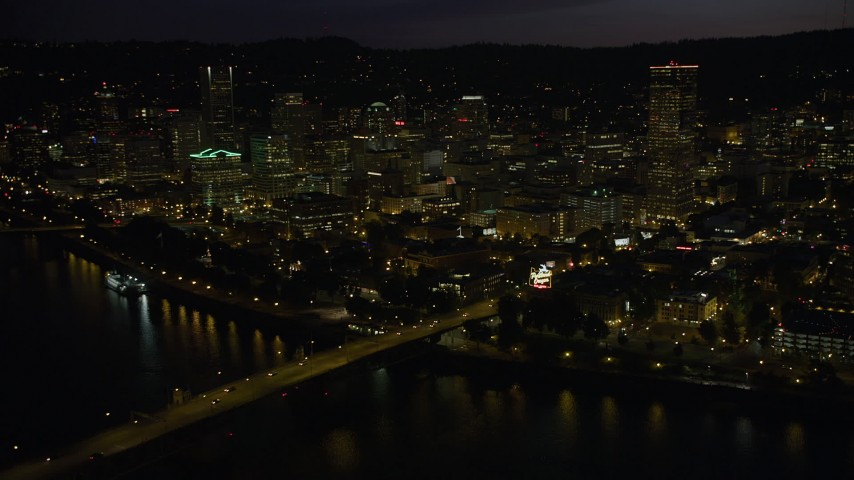 5K stock footage aerial video of following Burnside Street Bridge, approaching Downtown Portland, Oregon, night Aerial Stock Footage AX55_038