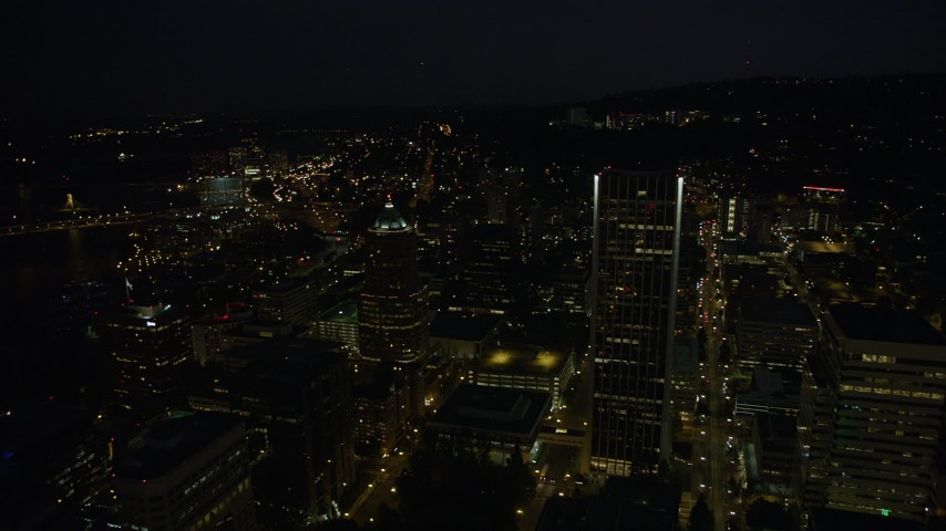 5K stock footage aerial video approach skyscrapers, pan to reveal Hawthorne and Marquam Bridges, Downtown Portland, Oregon, night Aerial Stock Footage | AX55_041