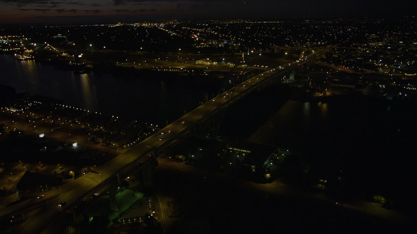 5K stock footage aerial video approach and flyby the Fremont Bridge, Downtown Portland, Oregon, night Aerial Stock Footage AX55_050 | Axiom Images