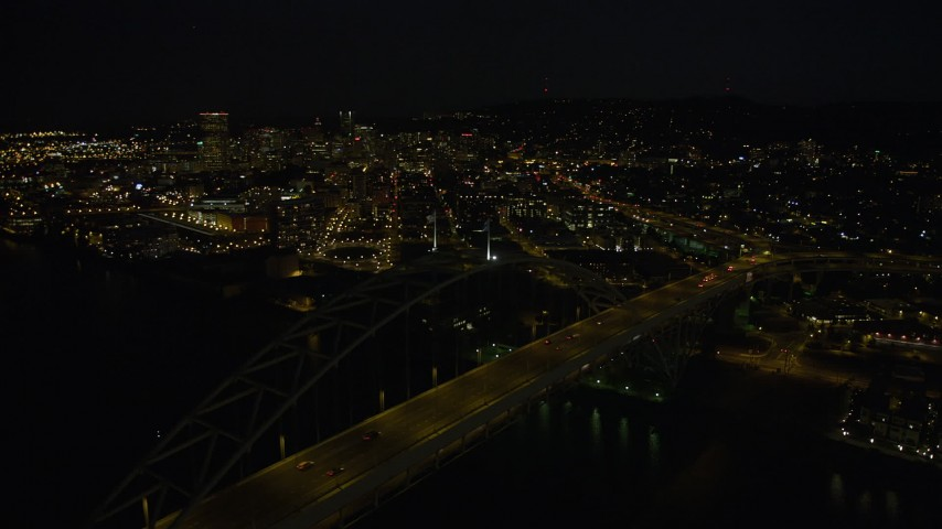 5K stock footage aerial video of orbiting Fremont Bridge to reveal Downtown Portland, Oregon, night Aerial Stock Footage | AX55_051