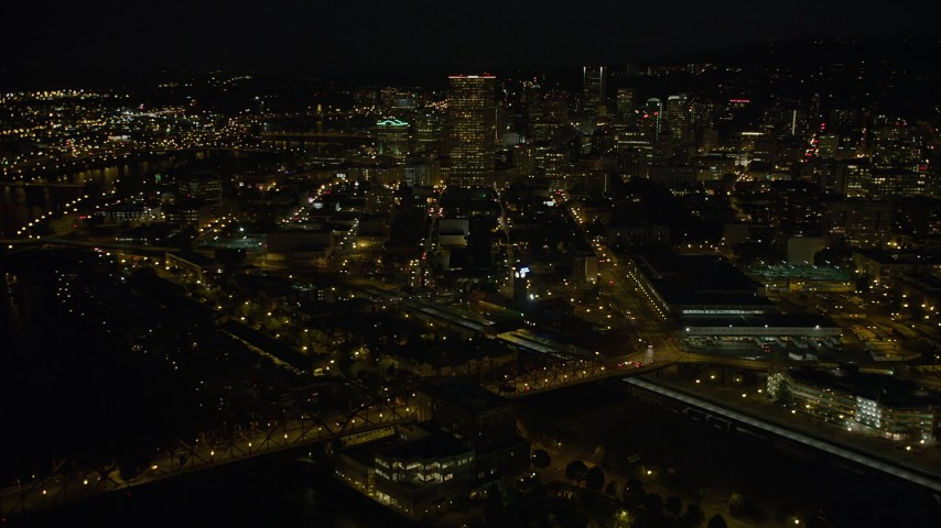 5K stock footage aerial video of approaching US Bancorp Tower from Union Station, Downtown Portland, Oregon, night Aerial Stock Footage | AX55_052