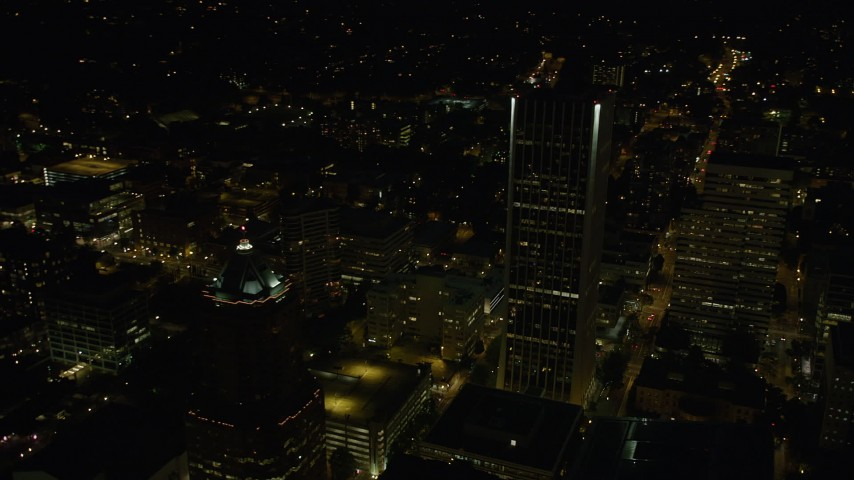 5K stock footage aerial video of flying by Wells Fargo Center, KOIN Center, Portland, Oregon, night Aerial Stock Footage | AX55_054