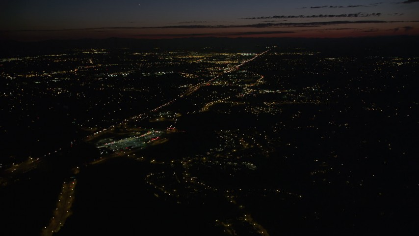 5K stock footage aerial video fly over suburbs to approach Highway 26 with light traffic in Southwest Portland, Oregon, night Aerial Stock Footage | AX55_061