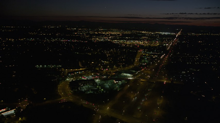 5K aerial video of flying over Highway 26 and shopping center, Beaverton, Oregon, night Aerial Stock Footage | AX55_066