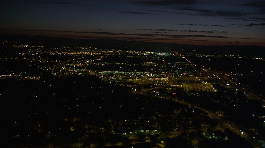 5K stock footage aerial video of approaching Tanasbourne Town Center, Hillsboro, Oregon, night Aerial Stock Footage | AX55_067