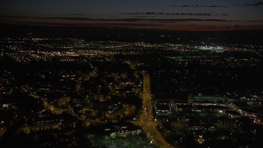 5K stock footage aerial video of approaching office buildings and wide streets, Beaverton, Oregon, night Aerial Stock Footage | AX55_068