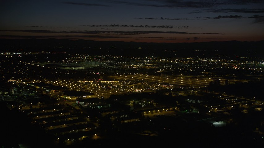5K stock footage aerial video pan across Intel Ronler Acres and office buildings, HIllsboro, Oregon, night Aerial Stock Footage | AX55_069