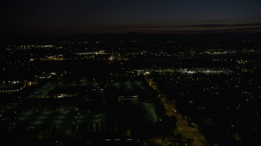 5K stock footage aerial video of flying over dark office building by neighborhood in Hillsboro, Oregon, night Aerial Stock Footage | AX55_071