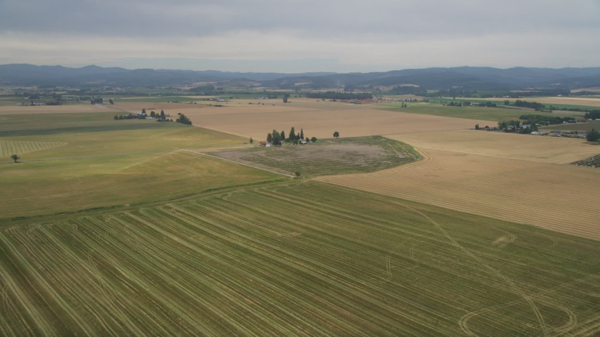 5K stock footage aerial video fly over fields to approach a small farm in Hillsboro, Oregon Aerial Stock Footage | AX56_004