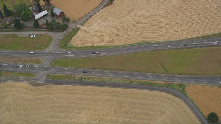 5K stock footage aerial video of bird's eye view of light traffic traveling on Highway 26, Banks, Oregon Aerial Stock Footage | AX56_011