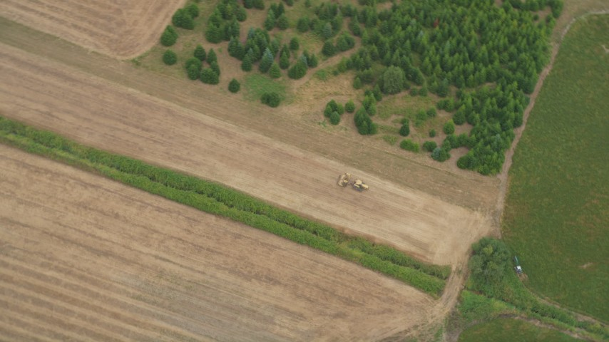 5K stock footage aerial video of bird's eye view of a tractor plowing a field, Banks, Oregon Aerial Stock Footage | AX56_012