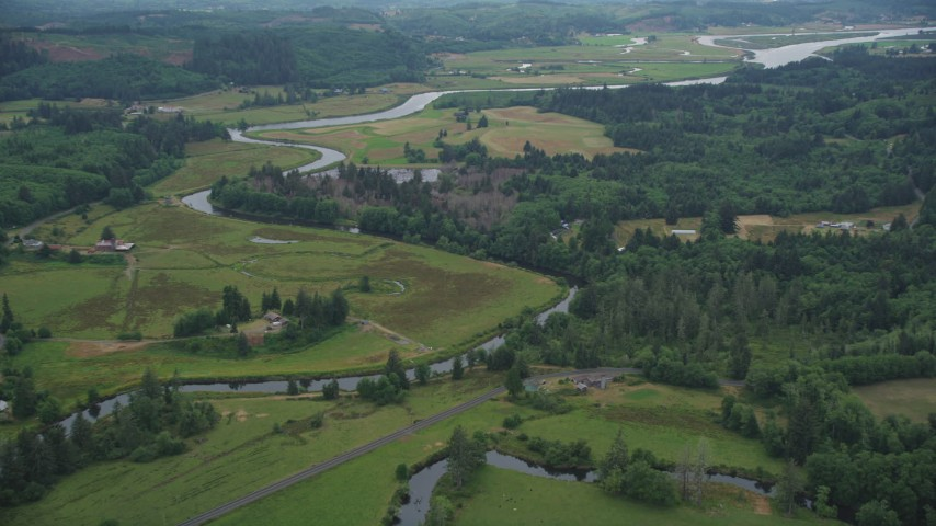 5K stock footage aerial video of ranch fields and ranch houses around the Youngs River in Astoria, Oregon Aerial Stock Footage | AX56_063