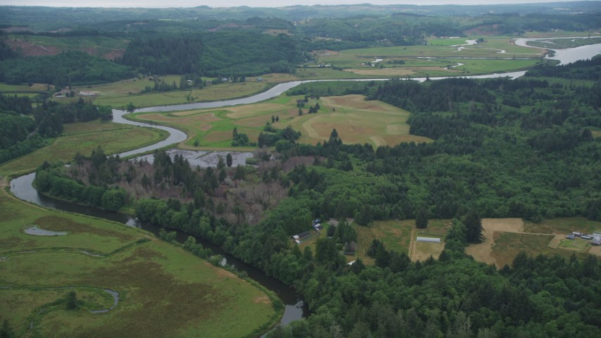 5K stock footage aerial video of Youngs River winding past ranches and fields in Astoria, Oregon Aerial Stock Footage | AX56_064