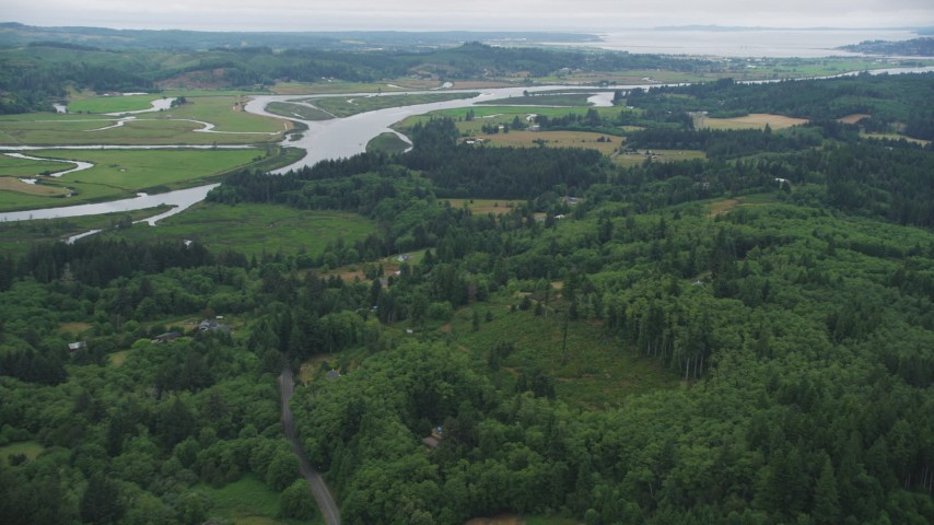5K stock footage aerial video approach rural homes by the Youngs River, with ranch fields on the other side, Astoria, Oregon Aerial Stock Footage | AX56_065