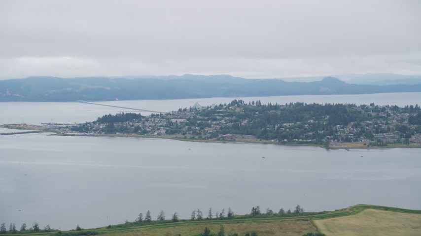 5K stock footage aerial video of the town of Astoria, Oregon, beside Youngs Bay Aerial Stock Footage | AX56_068