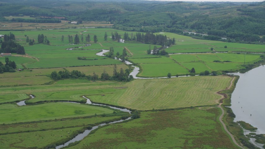 5K stock footage aerial video of farmland and small creeks beside Youngs River, Astoria, Oregon Aerial Stock Footage | AX56_069
