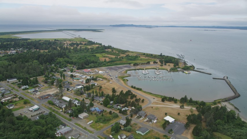 5K stock footage aerial video fly over homes, an RV park, and Hammond  Marina beside the Columbia River in Warrenton, Oregon