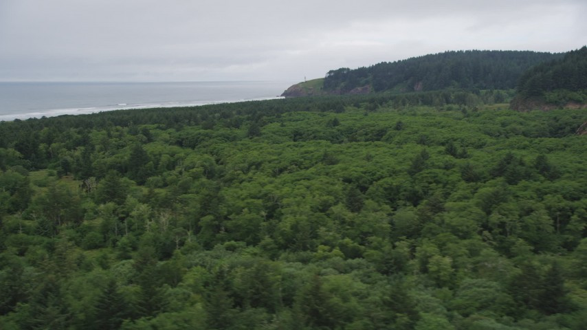 5K stock footage aerial video of North Head Light seen from Cape Disappointment State Park, Ilwaco, Washington Aerial Stock Footage | AX56_102