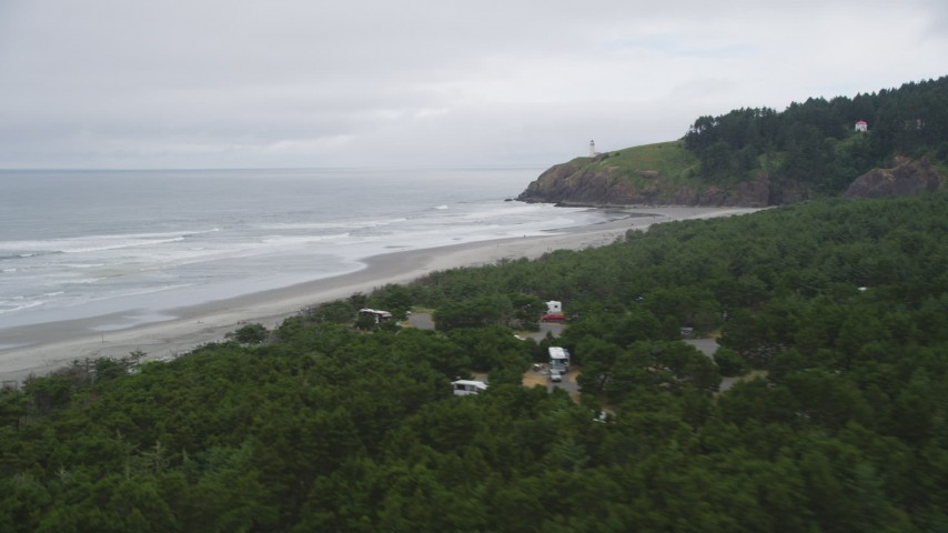 5K stock footage aerial video fly over Cape Disappointment State Park, reveal empty beach near North Head Light, Ilwaco, Washington Aerial Stock Footage | AX56_105