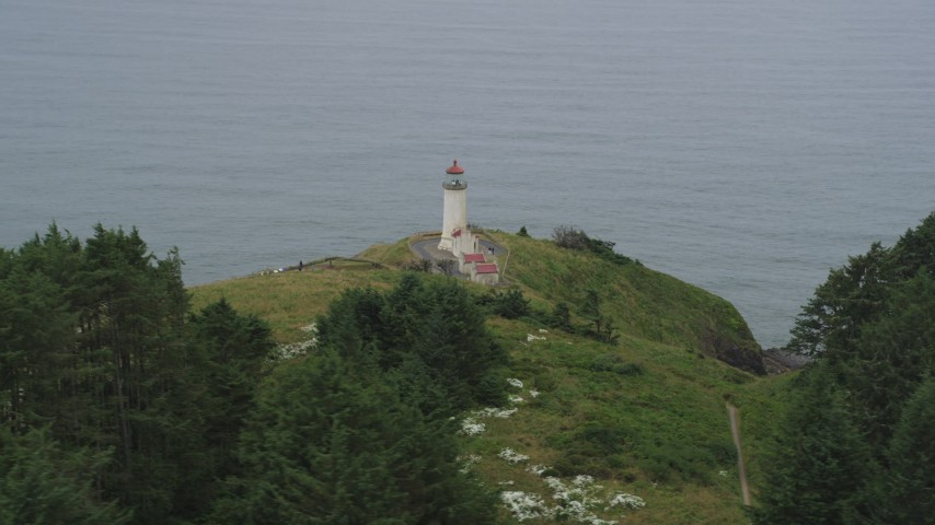 5K stock footage aerial video of the North Head Light, overlooking the Pacific Ocean, Ilwaco, Washington Aerial Stock Footage | AX56_113