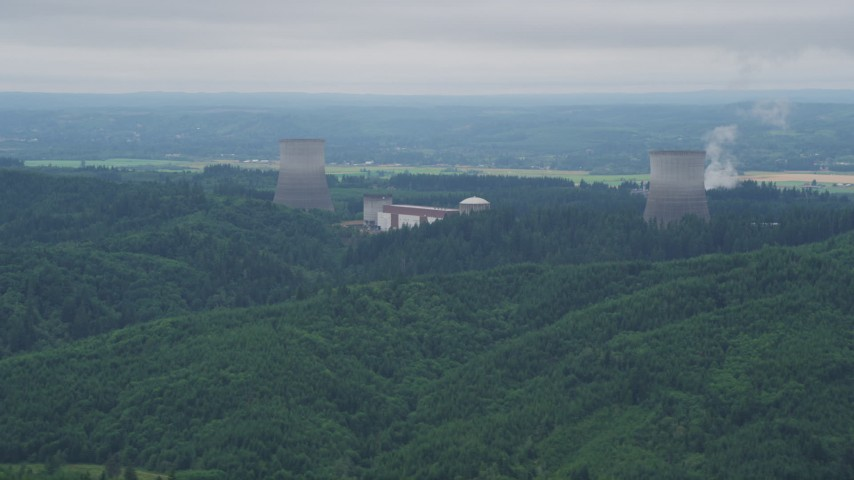 5K stock footage aerial video of Satsop Nuclear Power Plant cooling towers surrounded by forest, Satsop, Washington Aerial Stock Footage | AX57_009