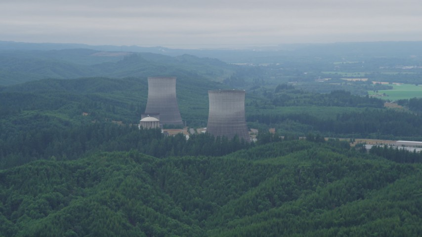 5K stock footage aerial video of a pair of cooling towers at the Satsop Nuclear Power Plant, Satsop, Washington Aerial Stock Footage | AX57_012