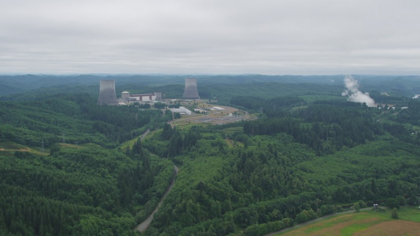 5K stock footage aerial video of Satsop Nuclear Power Plant surrounded by forest in Satsop, Washington Aerial Stock Footage | AX57_015