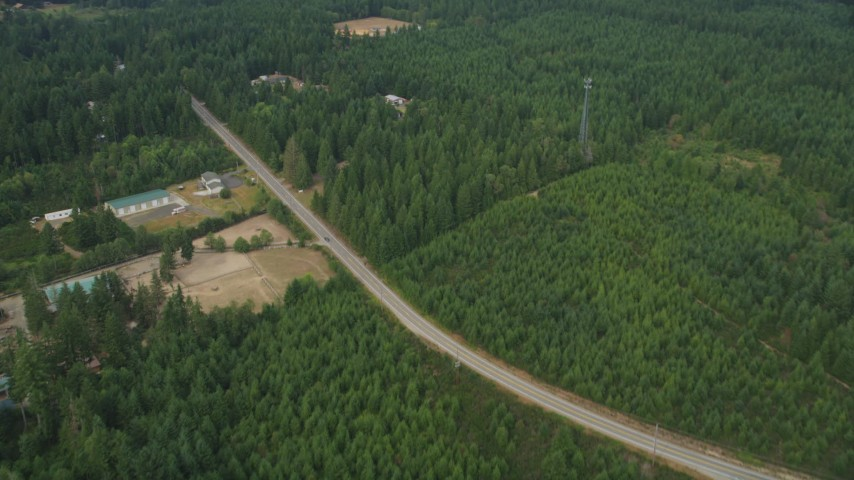 5K stock footage aerial video of rural homes and buildings beside Mason Benson Road, Grapeview, Washington Aerial Stock Footage | AX58_014