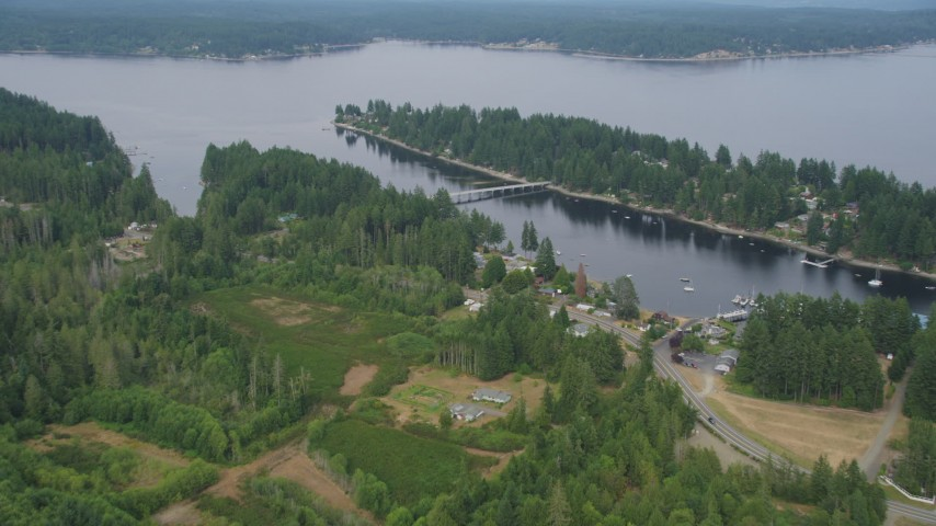 5K stock footage aerial video approach waterfront homes by the Treasure Island Road bridge to Reach Island; Grapeview, Washington Aerial Stock Footage | AX58_021