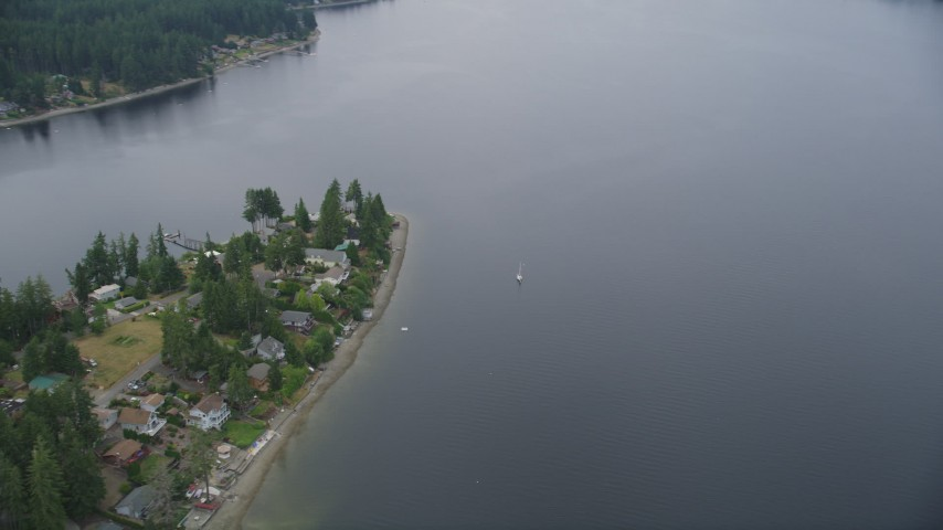 5K stock footage aerial video of sailboat on Case Inlet beside Reach Island waterfront homes, Grapeview, Washington Aerial Stock Footage | AX58_023