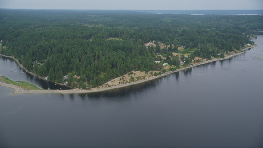 5K stock footage aerial video of waterfront homes, beach, and evergreens on the shore of Case Inlet, Vaughn, Washington Aerial Stock Footage | AX58_024