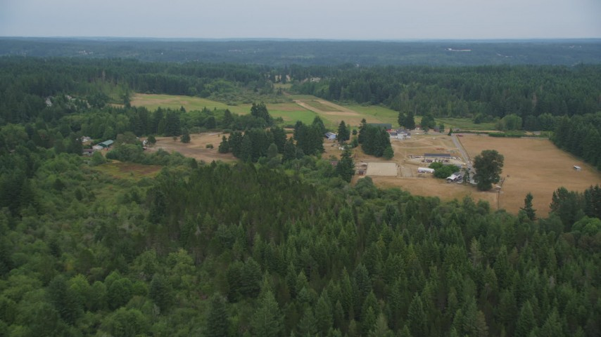 5K stock footage aerial video approach a small farm and fields in Gig Harbor, Washington Aerial Stock Footage | AX58_042