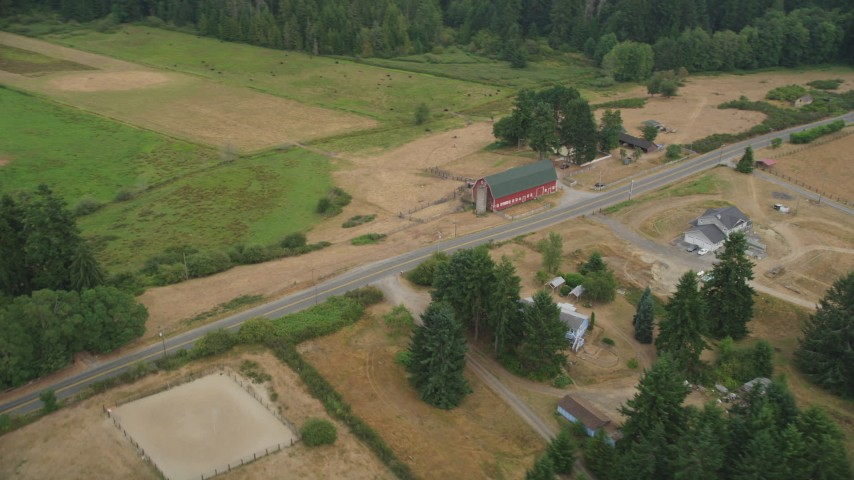 5K stock footage aerial video farm with a large red barn by a country road in Gig Harbor, Washington Aerial Stock Footage | AX58_043