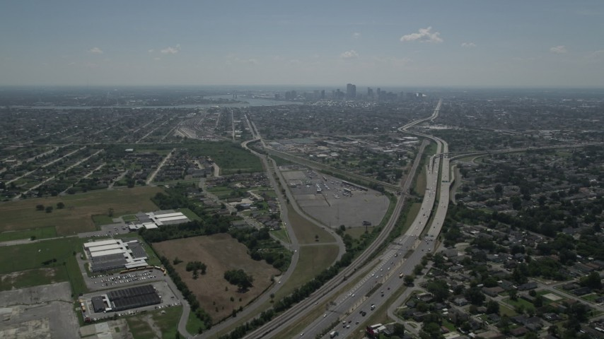 5K aerial video fly over I-10 through Gentilly to approach Downtown New Orleans, Louisiana skyline Aerial Stock Footage | AX59_002