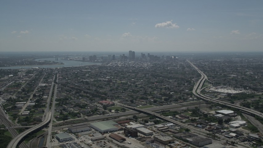 5K stock footage aerial video approach St Roch neighborhood and Downtown New Orleans skyline, Louisiana Aerial Stock Footage | AX59_003