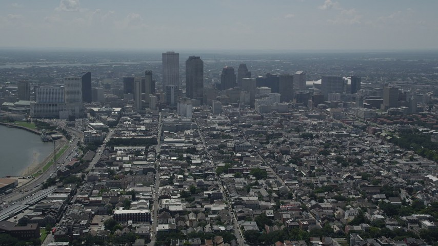 5K stock footage aerial video fly over the French Quarter to approach Downtown New Orleans, Louisiana Aerial Stock Footage | AX59_005