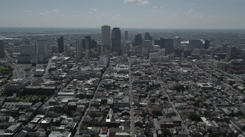 5K stock footage aerial video follow Bourbon Street through French Quarter to approach Downtown New Orleans, Louisiana Aerial Stock Footage | AX59_006